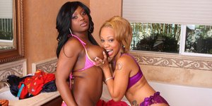 Ebony MILF lesbians Melrose and Jada stripping to lick pussy