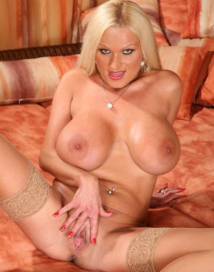 Sexy MILF babe Sharon Pink takes off lingerie to show her twat