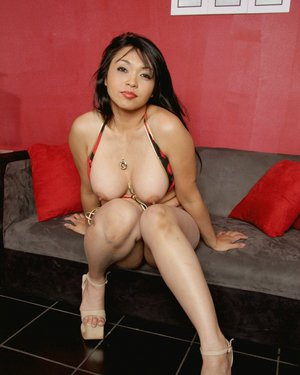 Asian milf babe Mika Tan spreading legs showing big tits and round ass