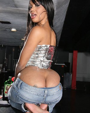 Ebony milf babe Kapri Styles shows ass and tiny tits taking off jeans