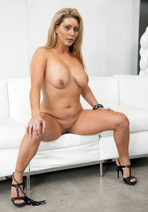 Big tits, ass and shaved pussy upskirt of milf Devon James are cool