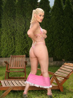 Blond big ass MILF stripping outdoor and spreading her pink pussy