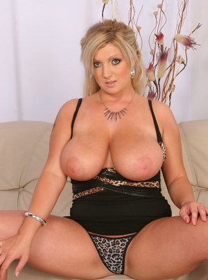 Big titted MILF strips and shows her BBW hooters and wet cooter