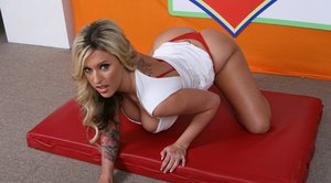 Big titted pornstar babe Memphis Monroe goes naked and poses