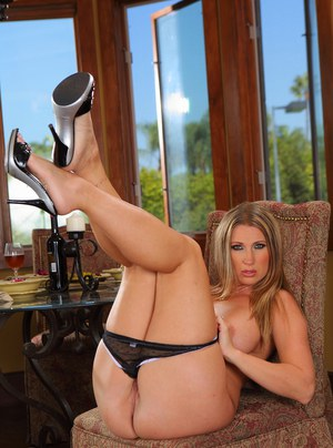 See nice ass and big tits of milf babe in high heels and lingerie