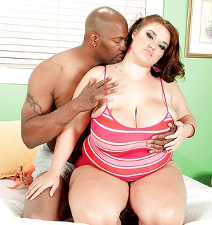 BBW redhead Lisa Canon denudes giant breasts and enjoys interracial sex