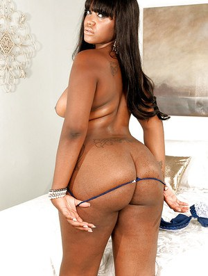 Ebony babe Aaliyah Envy posing in heels and getting her ass oiled up