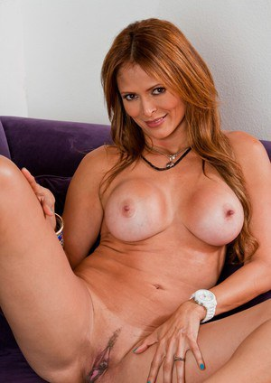 Mature latina Monique Fuentes denudes her comely tits and butt