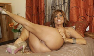 Mature latina Tara Holiday showing huge tits and sex-starved pussy