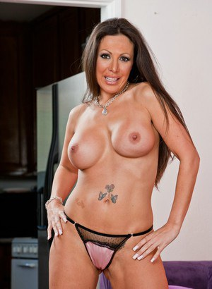 Mature seductress Amy Fisher exposing big tits and stretching legs