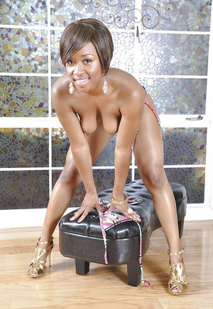 Black beauty Imani Rose posing solo in high heels and stripping