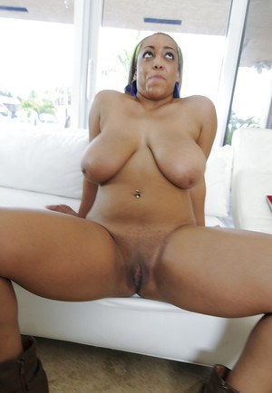 Black MILF showing her puffy breasts and smooth round booty