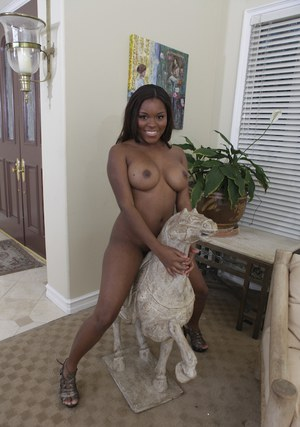 Hot african babe Candice Nicole strips off jeans and shows big tits