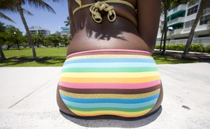 Big booty ebony girl Gemini strips off bikini panties on the beach