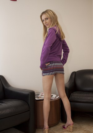 Teen babe with long legs Kelly Klass shows her ass upskirt in office