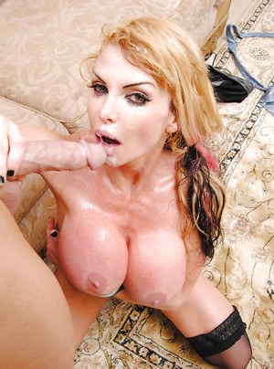 Busty MILF babe Taylor Wane fucks a monster cock after a blowjob