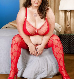 Mature fatty Danica Danali is spreading her legs and showing big tits