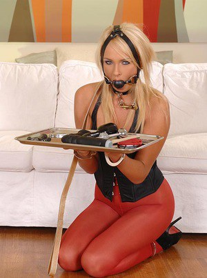 Sexy blonde in red pantyhose Ivana Sugar serving as a fetish fuck toy