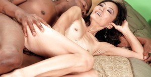 Mature asian Sahara Blue gets pounded by a huge black dick