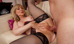 Gorgeous mom Nina Hartley shows her tits after a blowjob and has sex