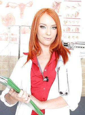 Redhead babe in uniform Dani Jensen stripping to her stockings