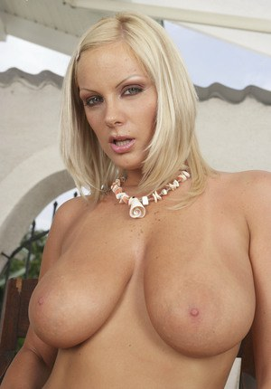 MILF babe with big juggs Sheila Grant takes of her bra and panties