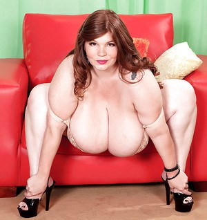 Fatty Anorei Collins poses in her lingerie stressing big boobs she has