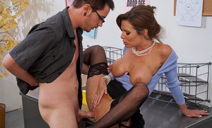 Gorgeous MILF Veronica Avluv stripped to stockings and fucked in office