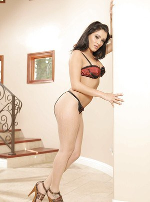 Latina babe Charley Chase shows her pornstar skills posing in lingerie