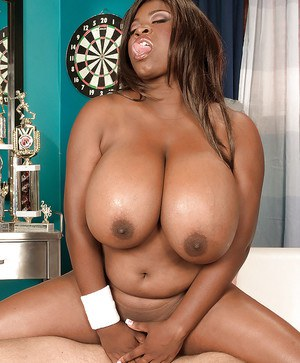 Black BBW Mianna Thomas denudes huge tits and mounts a cock