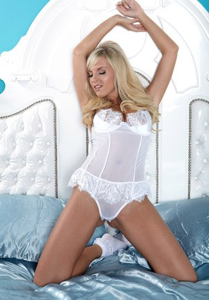 Exquisite blonde with big boobs disrobes from white lace lingerie