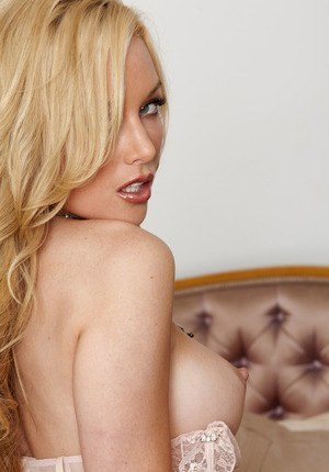 Busty babe Kayden Kross looks amazing masturbating in creamy stockings