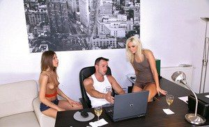 Two sexy babes with small tits sharing a stiff cock in the office