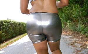 Busty black slut Paris exposes her sportive ass and hairy cunt outdoor