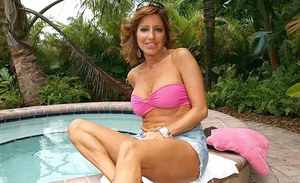 Mature Latina Tara Holiday enjoys swimming naked in her outdoor pool