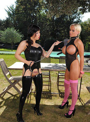 Lesbian MILFs in fetish lingerie and stockings playing with huge toys