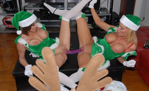 Kylani Breeze and her lesbian friend strap-on fucking at the Xmas party