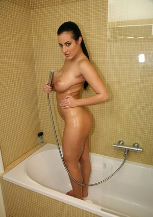 Busty brunette Carmen Croft caressing her huge tits in the shower