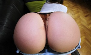 Playful european girl denudes and exposes her bubble butt