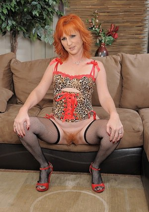 Fiery mature Sasha Brand posing in stockings and leopard lingerie