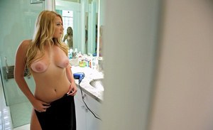 Adorable blonde Jessi Stone strips in the bathroom and sits on a toilet
