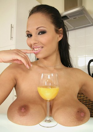 Voluptuous european babe shows off her huge tits in the kitchen