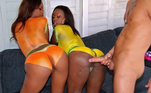 Two bootylicious black babes get hot jizz and paint on their butts