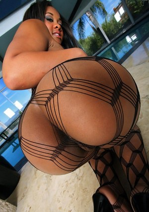 Ebony babe in pantyhose Candi Dreamz showing her shaved pussy