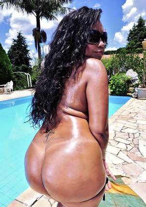 Latina babe Aninha Melo undressing to show her big tits and huge ass
