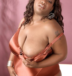 Fat black girl with huge tits Kayla Maze takes off her lingerie
