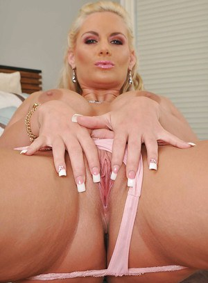Busty MILF with a big butt Phoenix Marie spreading her pussy