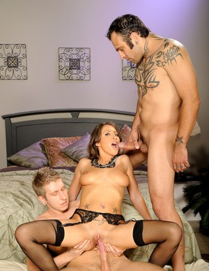 Busty babe in stockings gets her cunt fucked in a hot threesome