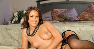 Gorgeous MILF babe Lizz Tayler shows her big tits and touches pussy