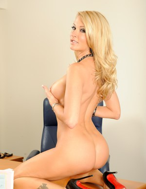 Hot babe with big tits Jessica Drake stripteasing in the office